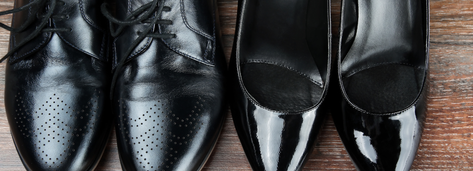 Close-up of a pair of shiny black leather dress shoes and heels after conditioning with Sof Sole® care products.