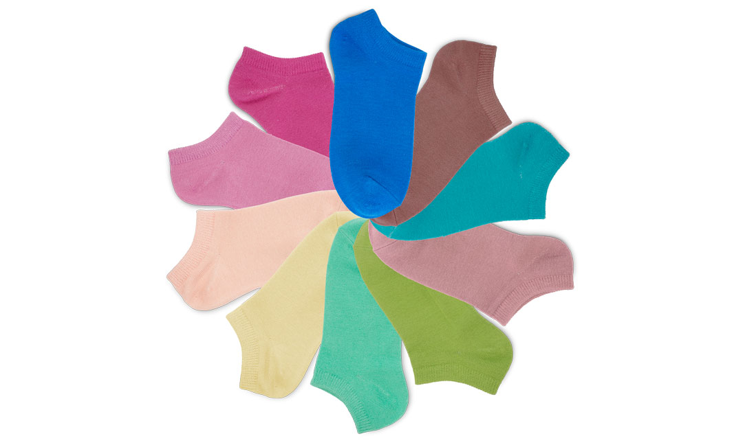 Fan of 10 colorful Wazi socks on a white background.
