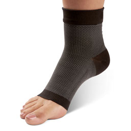 Black plantar fascia unisex sleeve worn on left foot with heel slightly raised on a white background.